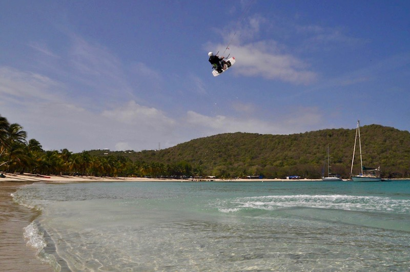 Matthew Pack flying through the air on a kiteboard